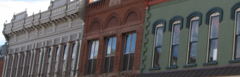 This is a photo I took of the 1900s upstairs buildings on the mainstream in Salida, CO. The ornate buildings are cream, dark red brick, and green and blue pained brick.